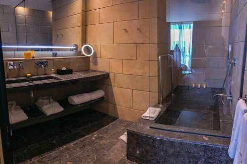 Black marbled bathroom with large bath