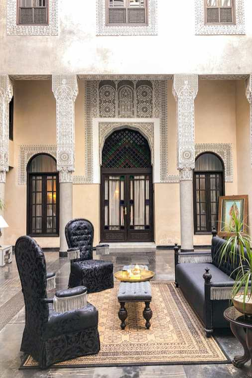 Black chairs and sofa in an arabic patio