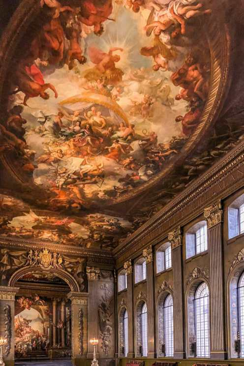 Painted ceiling in the baroque style with big arched windows