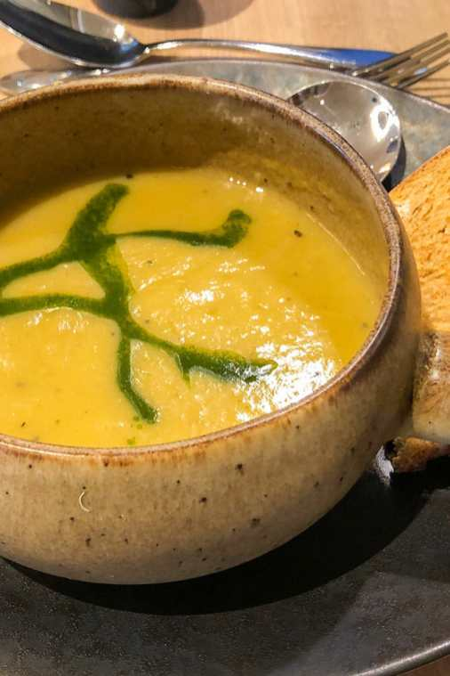Vegetable-and-coconut-soup-at-Arden-Cafe-Bar,-Studley-Castle,-Warwickshire