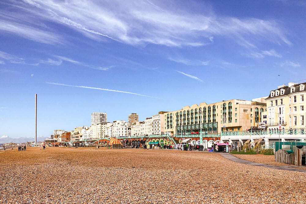 Pebbled beach in Brighton with buildings in the background