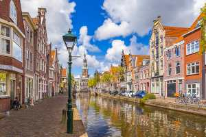 Canal with typical Dutch houses on both sides. Alkmaar is one of the most beautiful cities in the Netherlands