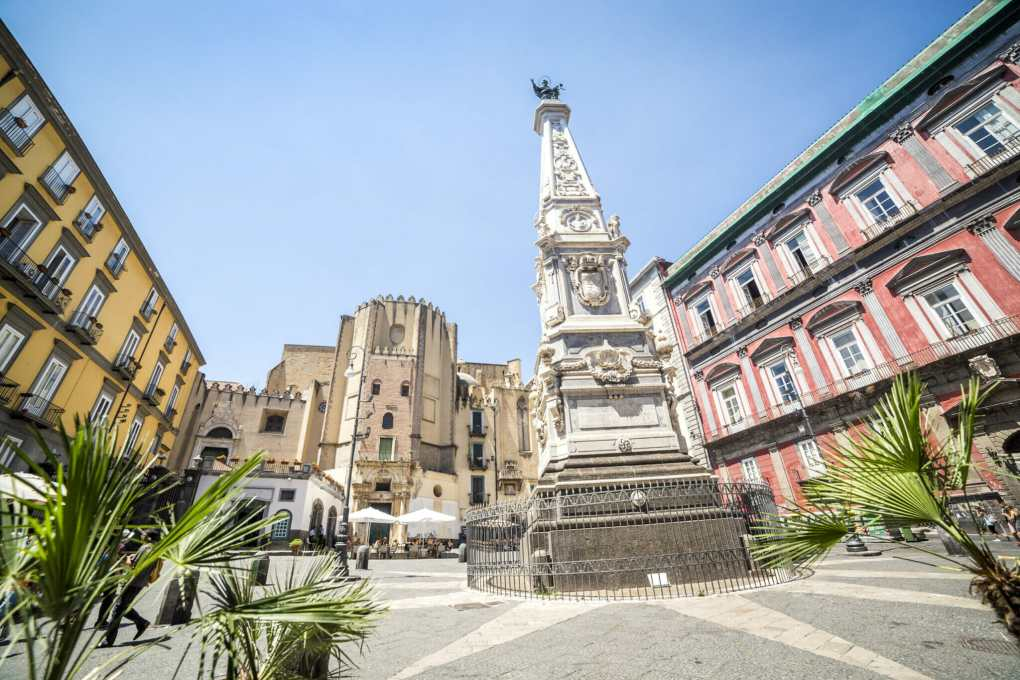 Neapolitan square with a monument in the center, Italy