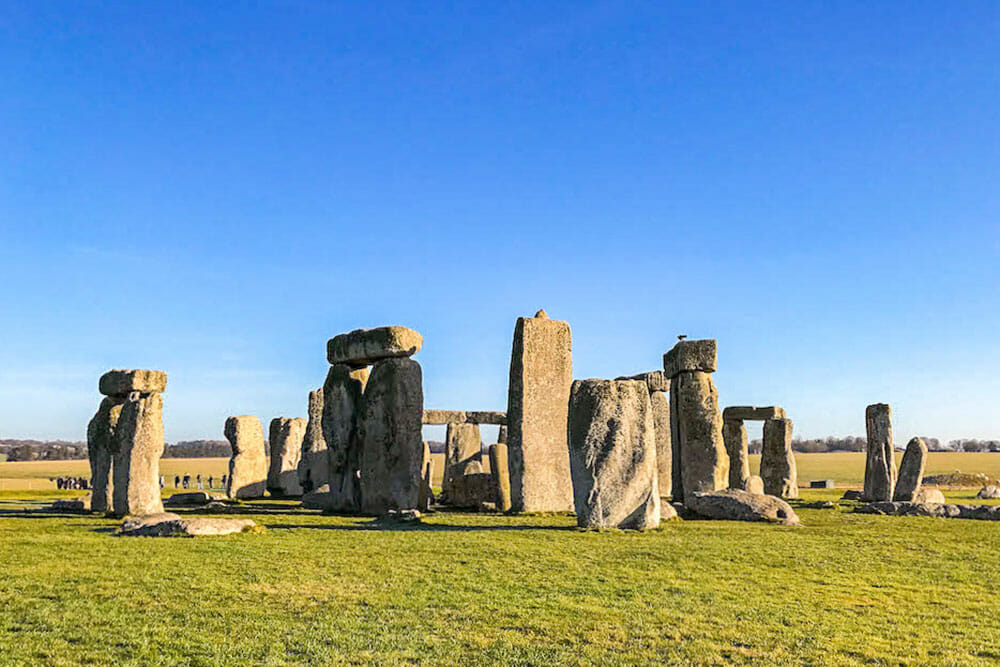 Stonehenge stone circle on an open field, one of the most popular day trips from London