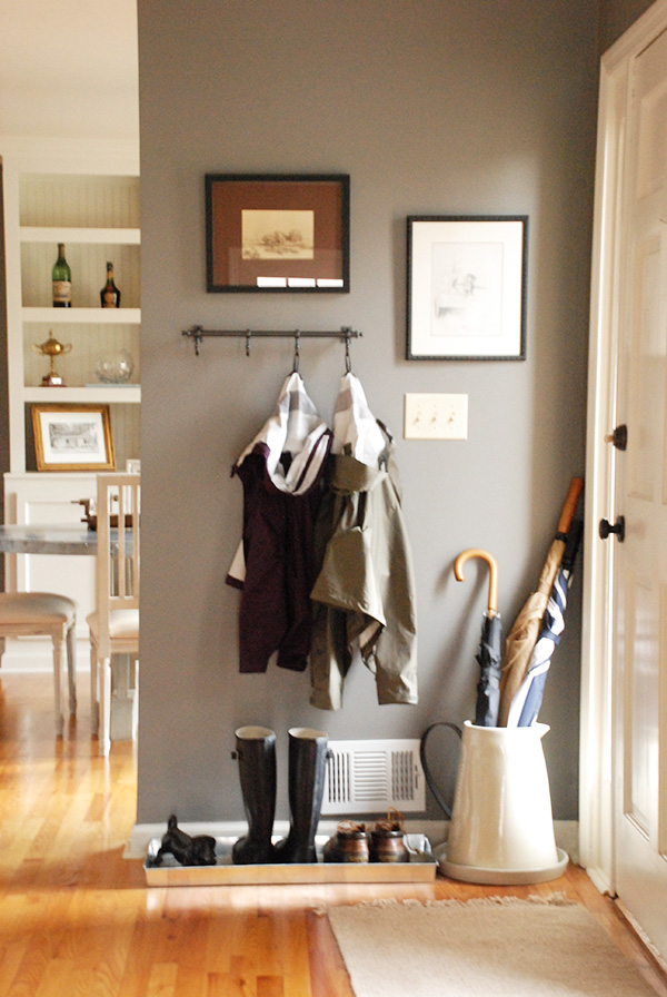 Entryway with hooks shoes and umbrellas