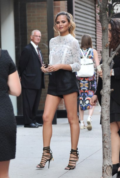 chrissy teigen rose gold black shorts high neck street style