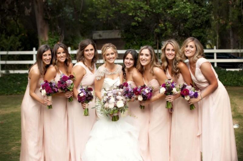bridesmaids bride pink dresses bouquets