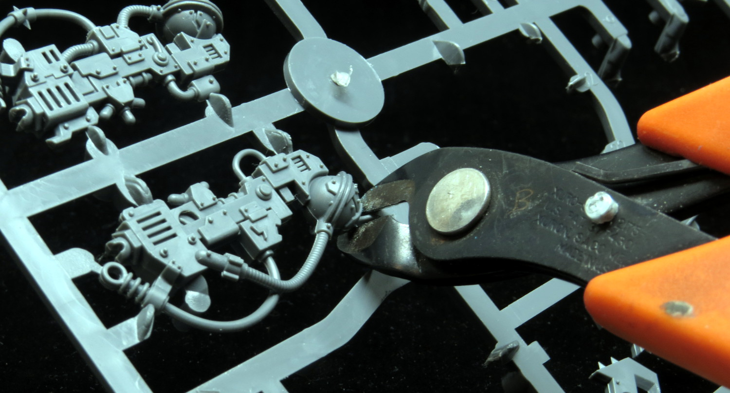 A flush cutter, or sprue clipper, is a tiny set of scissors with a flat  edge. To cut out the bits, press the flat side against the part you want to  keep ...