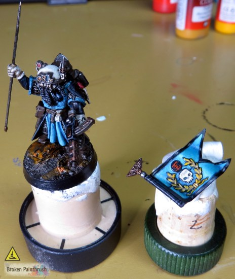 Using sticky tack and a cork to hold a miniature for painting