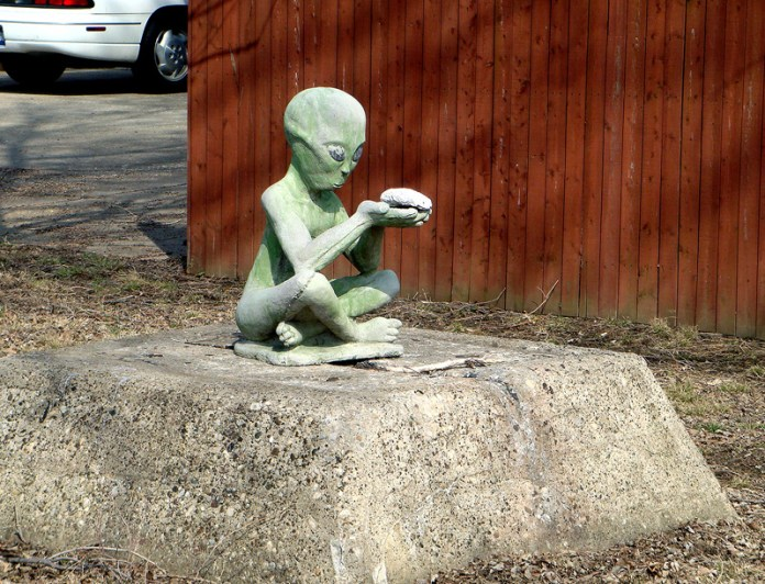 Alien sits in Jeffersonville, pondering brain. (Branden Klayko / Broken Sidewalk)