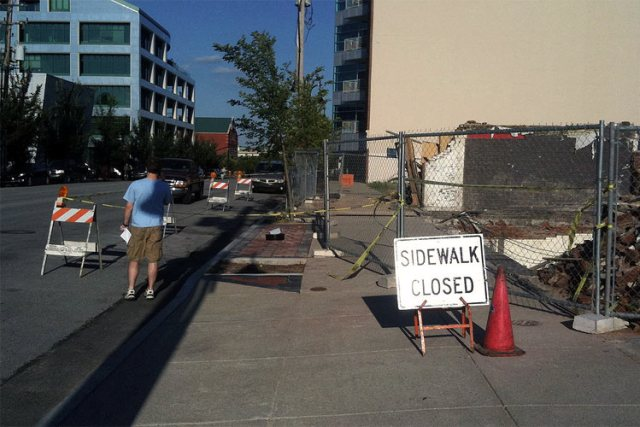 Sidewalk closed on East Main Street for St. Elmo's demolition. (Erik Weber)