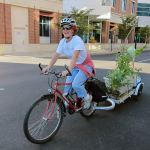 Amanda Fuller transports a park-ful of plants by bike. (Mary Beth Brown)