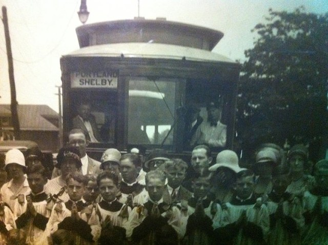 A group from St. Elizabeth's Church stands in front of a trolley on Burnett Street. (Courtesy G-town/S-burg Facebook)