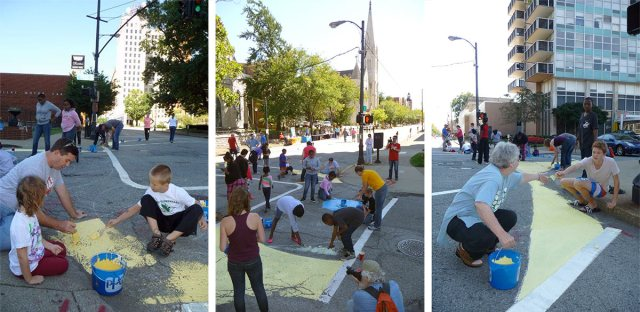 Painting the intersection of Fourth and York streets. (Elijah McKenzie / Broken Sidewalk)