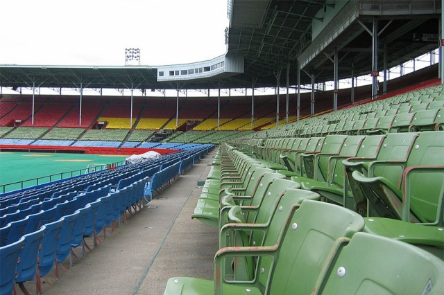 Colorful seats in the grandstand section of Old Cardinal Stadium. (Courtesy Wikipedia)