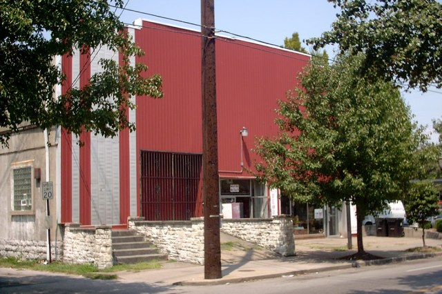 For years, the building was covered in a red metal facade. (Branden Klayko / Broken Sidewalk)