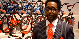 Promise Land Missionary Baptist Church Pastor Bishop Michael Priester in front of the bikes that were given to children. (Courtesy WDRB)