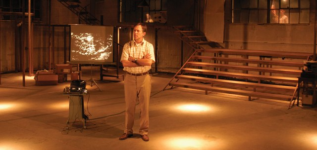 Bruce McKenzie takes the stage as the Photographer in the 2004 Humana Festival premiere. (Harlan Taylor / Courtesy Actors Theater)