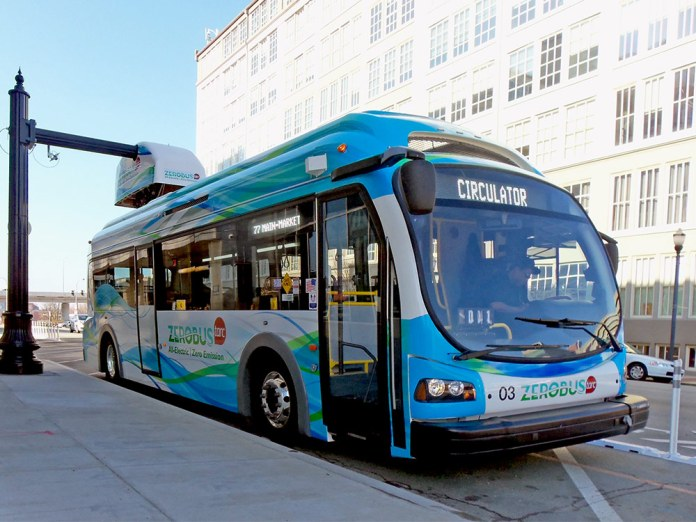 A ZeroBus charges at a stop on West Market Street. (Darius Pinkston / Flickr)