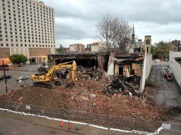The Morrissey Parking Garage and the Falls City Theater Co. building under demolition on Third Street. (Diane Deaton-Street)