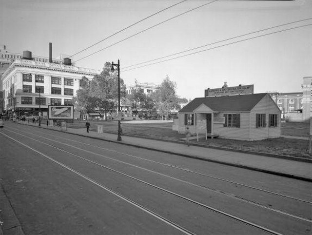 Hocking suburban housing (and billboards in the background) in park space. (UL Photo Archives)