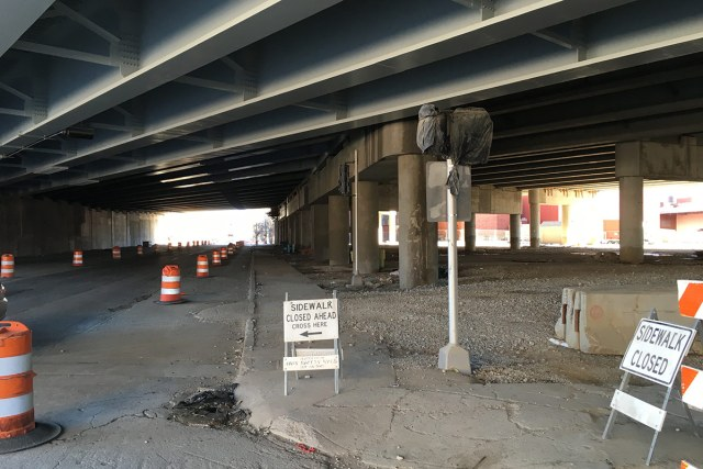An enormous elevated highway hovers over the corner opposite the parking garage. (Branden Klayko / Broken Sidewalk)