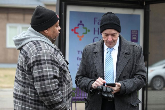 Ted Smith tries out a Russell Wi-Fi hotspot. (Courtesy Mayor's Office)