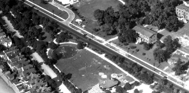 Aerial view of Third Street Triangle Park, now Stansbury Park, circa 1928, showing a large children's play pool, lawn, and bandstand. (Courtesy Stansbury Park Master Plan)