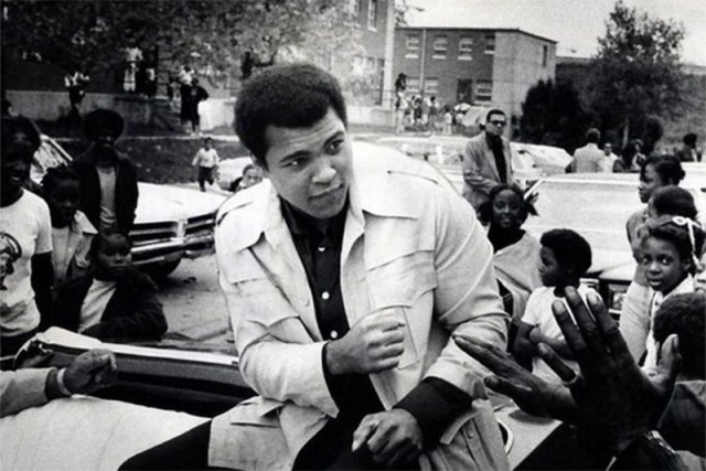 Muhammad Ali drives through Smoketown's former Sheppard Square Homes after winning a championship. (Courtesy Courier-Journal / via Metro Louisville)