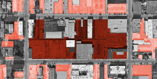 A map showing parking lots on the target block and parking on surrounding blocks in a lighter shade. (Map via Google / Montage by Broken Sidewalk)