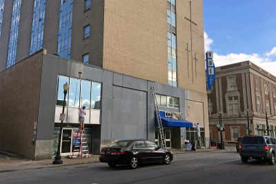 Cover-Up: Vue apartments paints over limestone base with dull gray tone