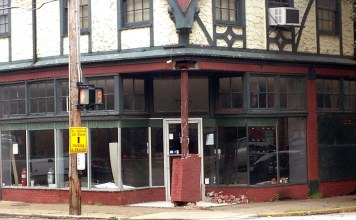 Damage from a motorist hitting a building in Old Louisville. (Branden Klayko / Broken Sidewalk)
