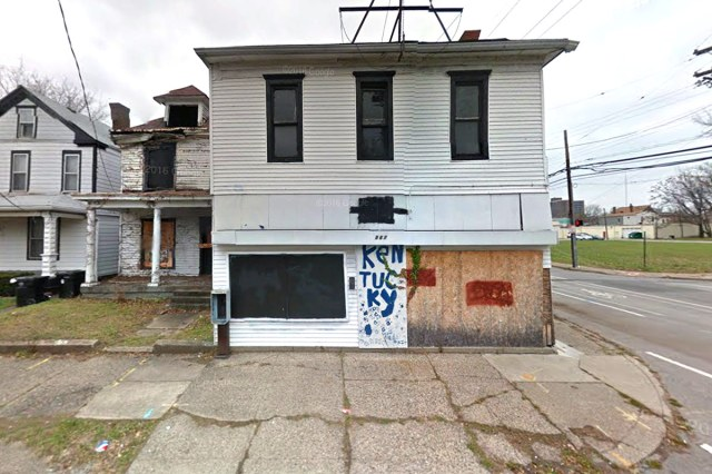 The boarded up grocery store building today. (Google Street View)