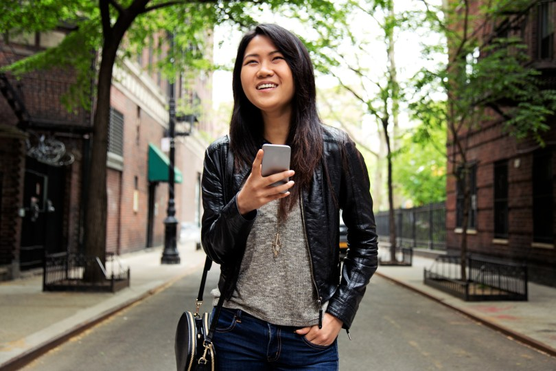A young woman with smart phone in New York city.