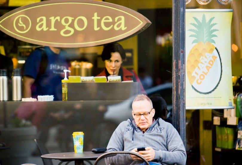 """New York, USA  - May 1, 2012: Mature Man sitting in outdoor cafe with free-wifi, New York"""