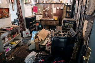 Adam Pomerantz, landlord and owner of Murray's bagels showing the apartment of late actress Patricia O'Grady who was paying about $29 rent for her apartment. 498 6th Ave, Manhattan, NY photo by Stefano Giovannini (Photo Via Ghotamist.com)