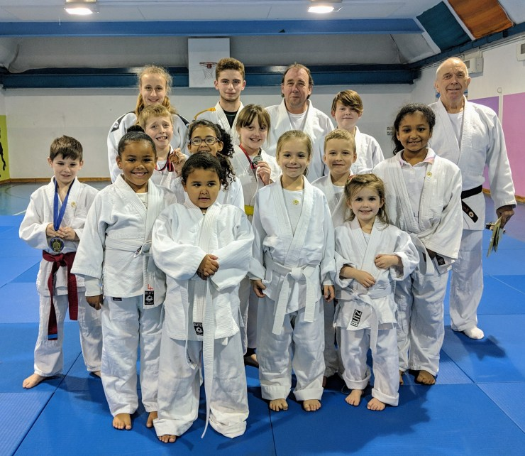 The judoka from Bromley Judo Academy's first mat standing with the coaches and junior coaches