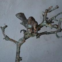 UNICA- vogeltje op bronzen tak, UNICA.