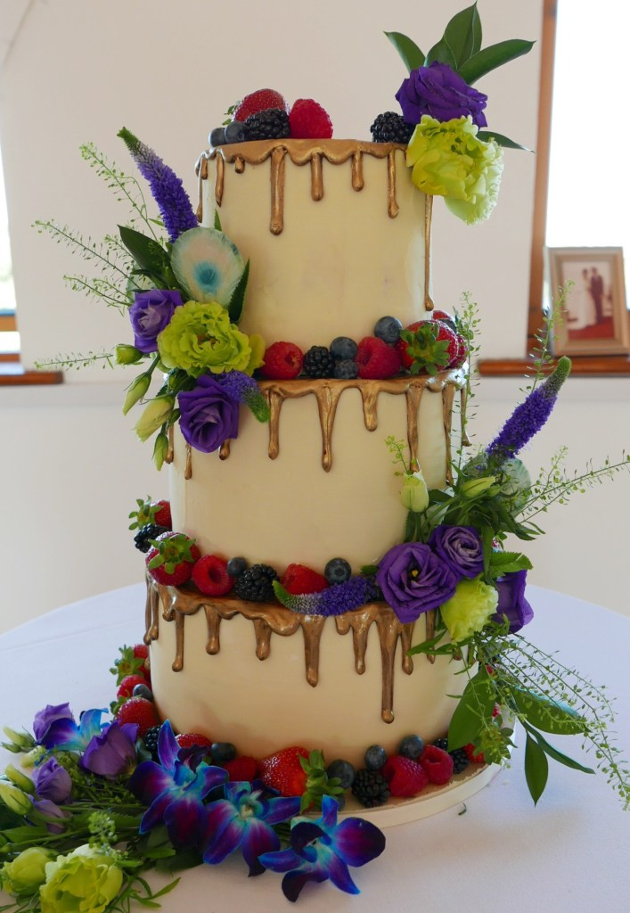 white chocolate wedding cake with an antique gold drip