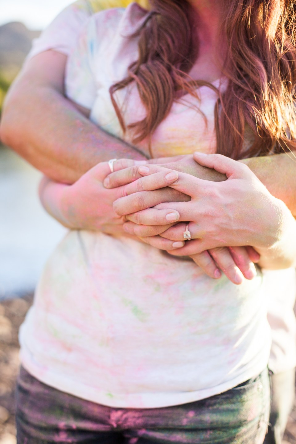 couple holding each other after a color fight with vintage engagement ring
