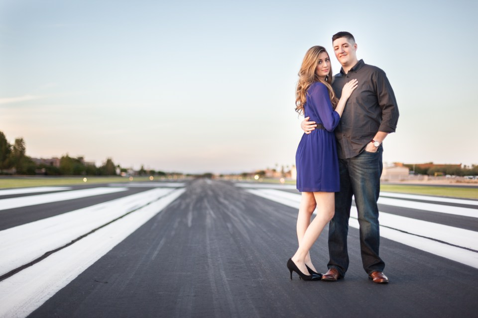airport engagement pictures on tarmac