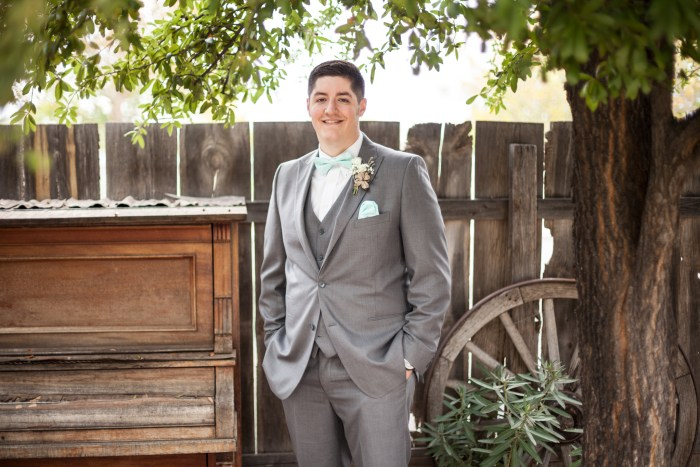 groom with grey suit and tiffany blue bowtie and pocket square