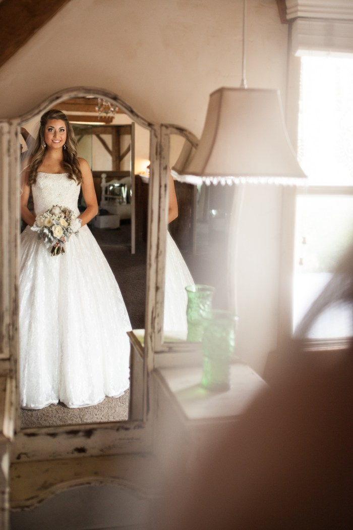 rustic bride looking in the mirror