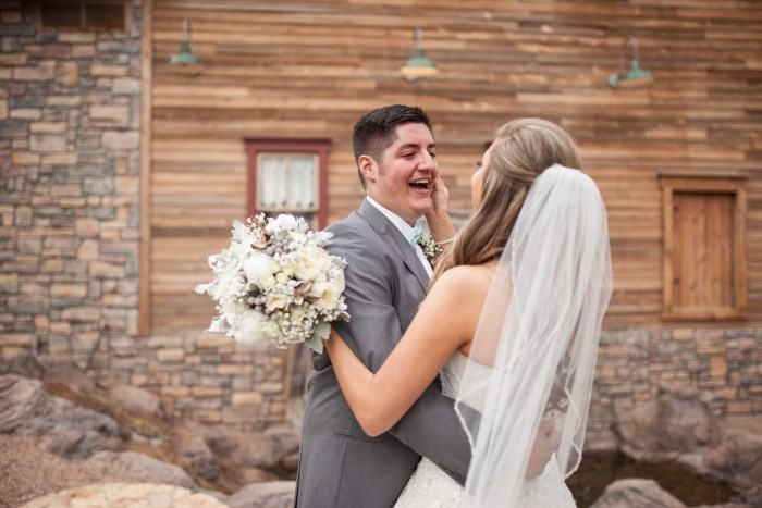 bride and groom first look with rustic cotton bouquet