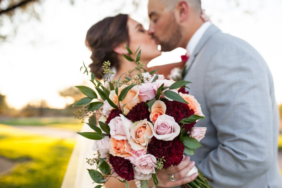 bride and groom with fall wedding bouquet