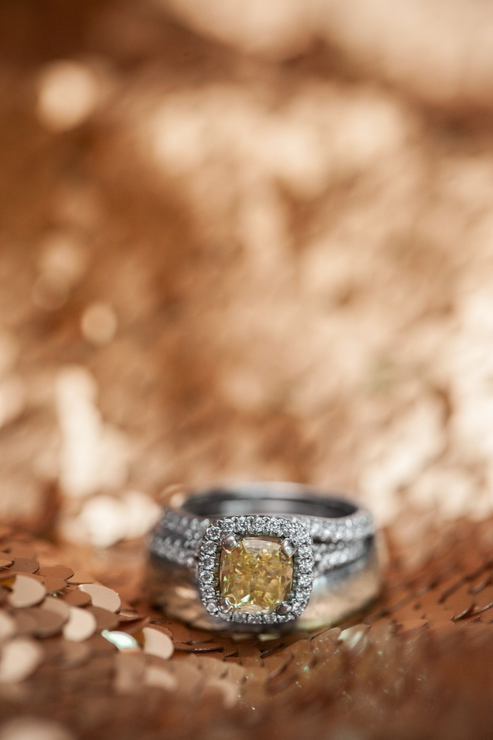 yellow diamond engagement ring with halo