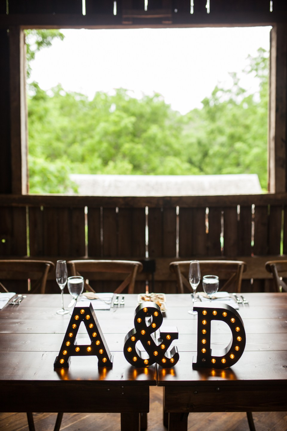 wedding reception in the barn of The Farm at Dover head table with marquee letters