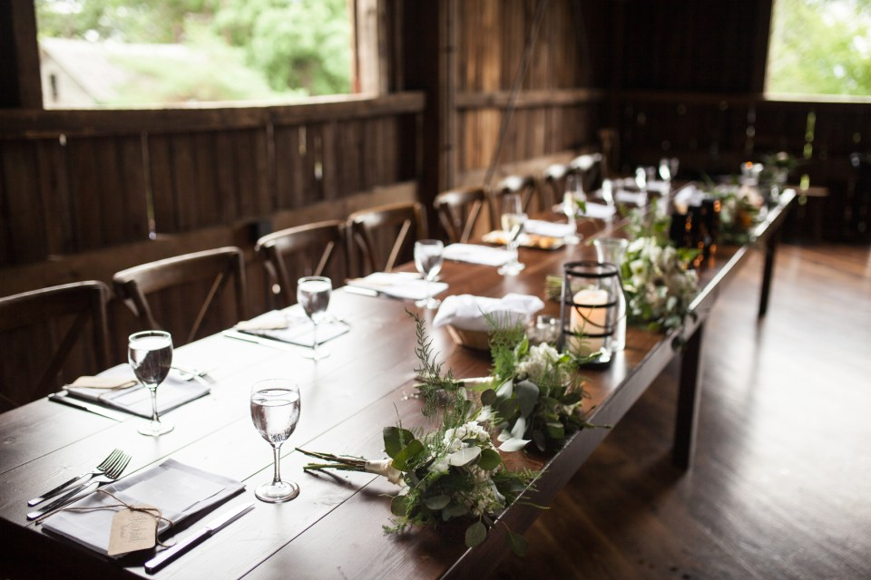 wedding reception in the barn of The Farm at Dover tablescape with flowers by Gia Bella Flowers
