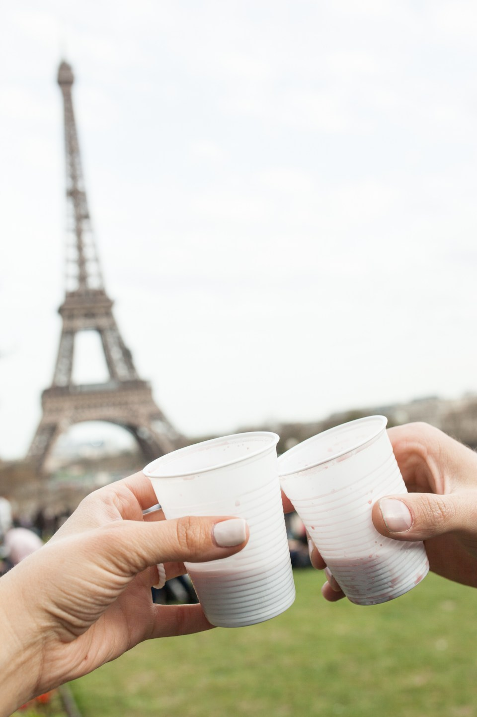 sharing wine beneath the Eiffel Tower in Paris France