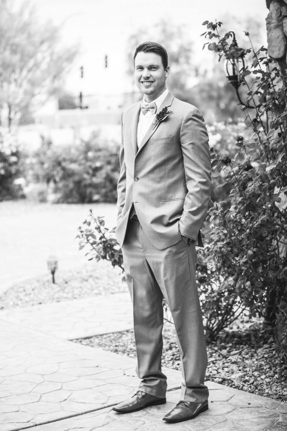 groom wearing grey suits and vests